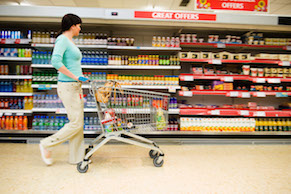 Shopper with Cart in Supermarket